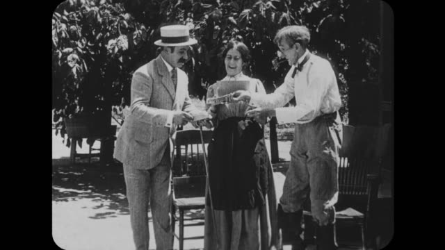 1916 farming couple buy from suited stranger - 1916 stock videos & royalty-free footage
