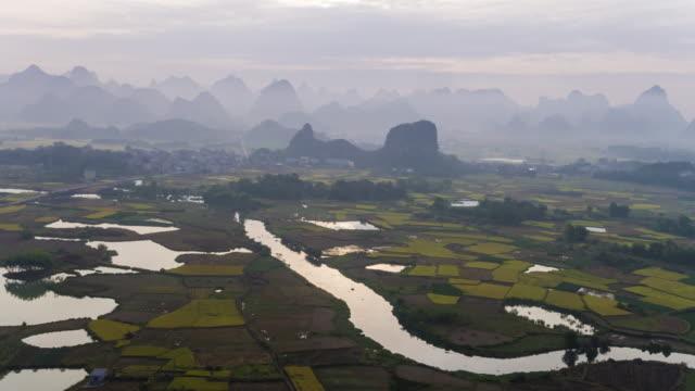 farmland and karst landform dusk,xingping,yangshuo,guilin,china - yangshuo stock videos & royalty-free footage