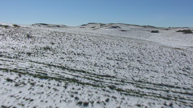 ws tu aerial pov farmland covered with snow / north dakota, united states - farm stock videos & royalty-free footage