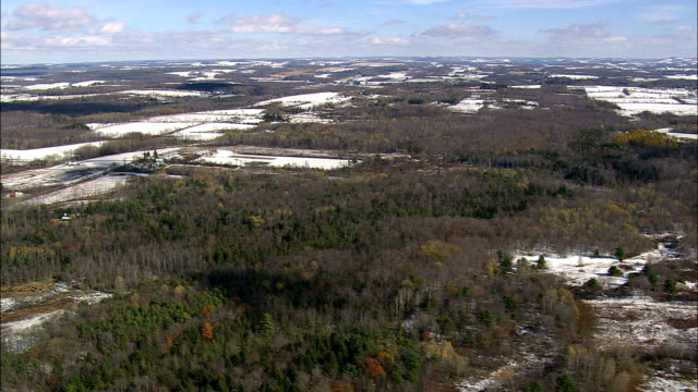 farmland dusted with snow - aerial view - new york,  cayuga county,  united states - cayuga stock videos & royalty-free footage
