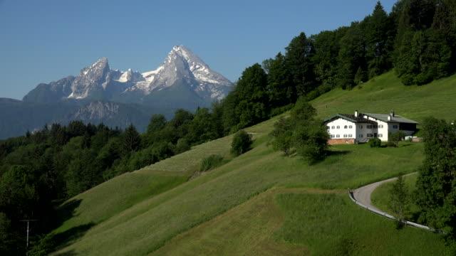 farmland in the mountains near maria gern against watzmann mountain (2713m), berchtesgaden, upper bavaria, bavaria, germany - alps stock videos and b-roll footage
