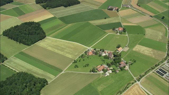 vídeos y material grabado en eventos de stock de aerial farmland, kirchberg, bern, switzerland - paisaje mosaico