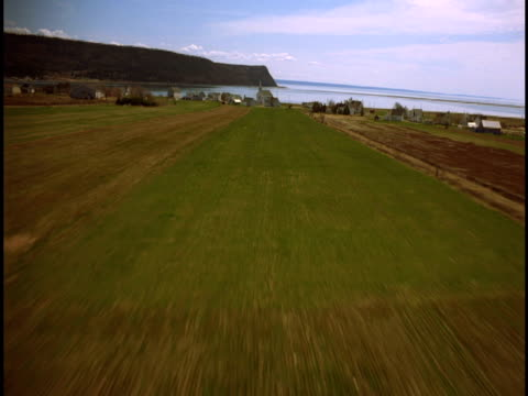 Farmland leads to a tiny village of the Bay of Fundy.