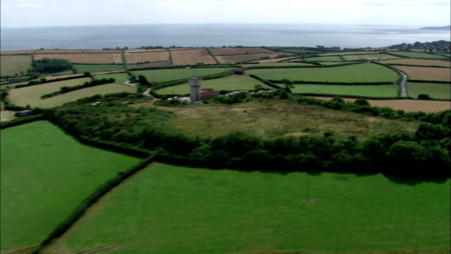 Farmland runs along a section of the southwest coast of England. Available in HD.