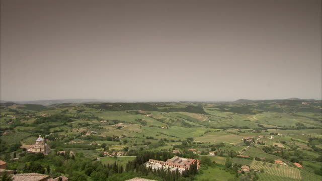 farmland surrounds montepulciano, italy. available in hd. - tuscany stock videos & royalty-free footage