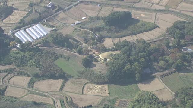 Farmland surrounds  the Takamatsuzuka Tumulus in Nara, Japan.