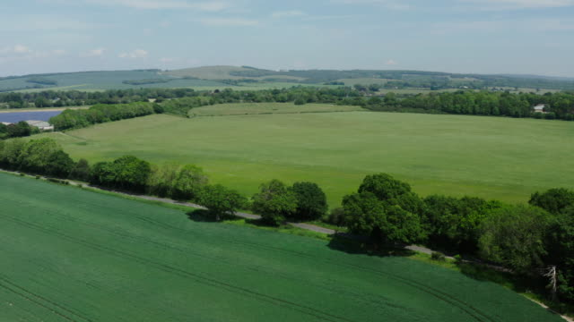 farmland with south downs in distance - springtime stock videos & royalty-free footage