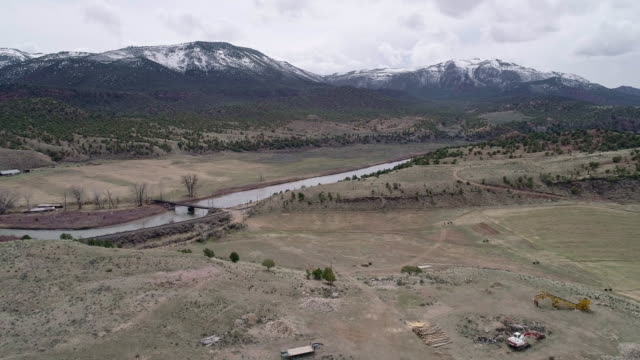 farmlands in colorado mountains, nearby mccoy, and colorado river, in the early spring. aerial drone video with the forward and ascending camera motion. - deer stock videos & royalty-free footage