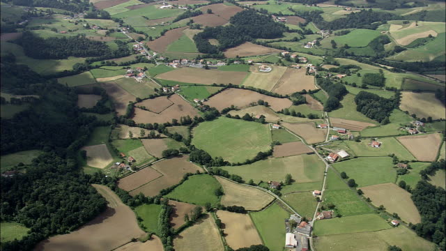 farms and fields  - aerial view - aquitaine,  pyrénées-atlantiques,  arrondissement de bayonne helicopter filming,  aerial video,  cineflex,  establishing shot,  france - aquitaine stock videos and b-roll footage