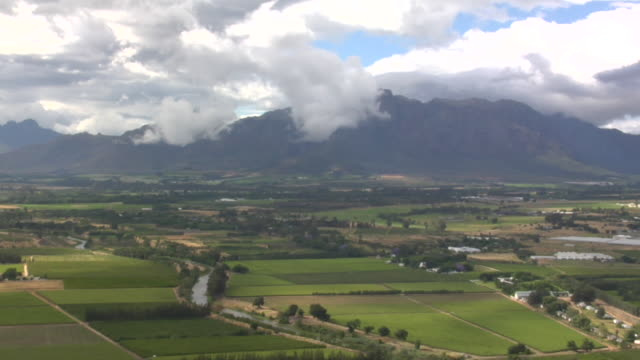 farms and vineyards cover the landscape. available in hd. - paarl stock videos & royalty-free footage