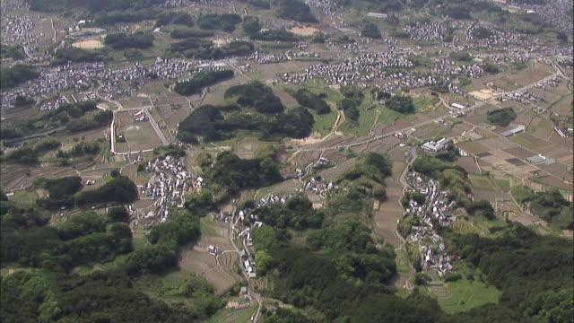 farms, houses, and roads encircle the kitora tumulus in nara. - 大昔の点の映像素材/bロール