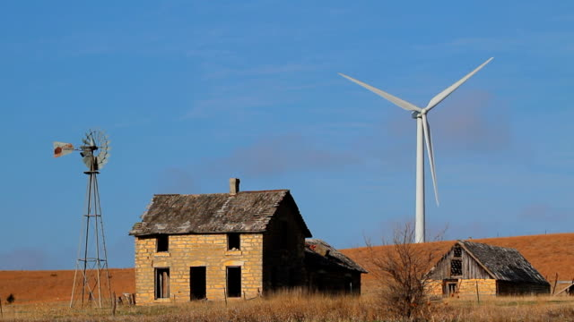 farmstead single old new wind turbine - prairie stock videos and b-roll footage