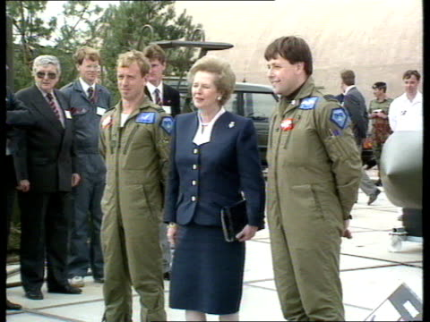 02 farnborough air show gv of mrs thatcher arriving at farnborough air show and greeted by officials / mrs thatcher being shown helicopters and... - rolls royce stock videos & royalty-free footage