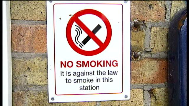 farningham road railway station: 'no smoking' sign train platform and tracks train through station - no smoking sign stock videos & royalty-free footage