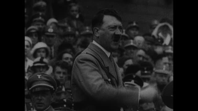 fascist dictator benito mussolini gesturing speaking ms hitler speaking at rally german italian la french troops marching wwii - marching stock videos and b-roll footage