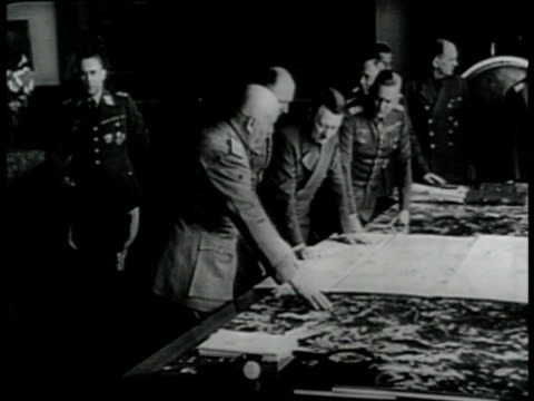 fascist dictator benito mussolini in uniform standing looking at papers on table w/ nazi german leader hitler w/ erwin rommel & other officers bg... - northern european stock videos & royalty-free footage