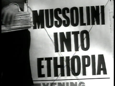 fascist dictator benito mussolini on balcony w/ officials laughing. poster 'mussolini into ethiopia.' ext ethiopian emperor haile selassie i sitting... - benito mussolini stock videos & royalty-free footage