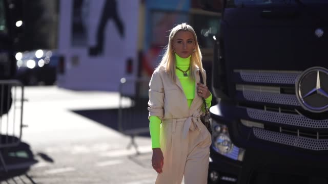 fashion blogger queen of jet lags wears a green turtleneck a white jumpsuit outside margiela during paris fashion week womenswear spring/summer 2019... - jumpsuit stock videos & royalty-free footage