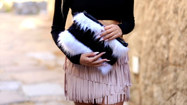 fashion blogger shows her autumn outfit - purse stock videos & royalty-free footage