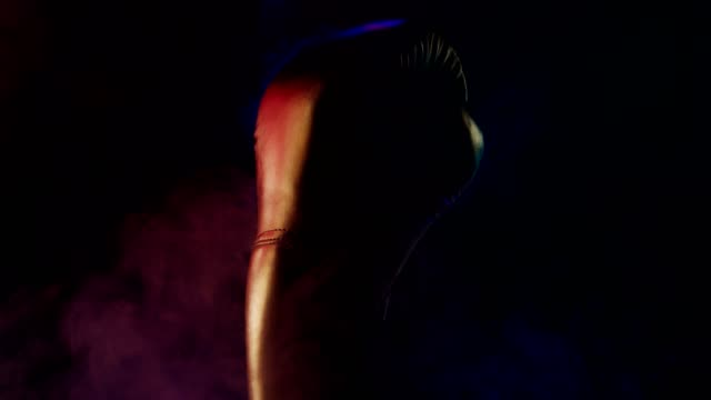 fashion boxing glove shows display over black background - glove fist stock videos & royalty-free footage