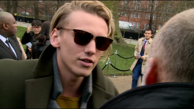 vidéos et rushes de burberry prorsum men's collection show jamie campbell bower arriving and conducting interview with other crew / jamie campbell bower interview sot - burberry prorsum