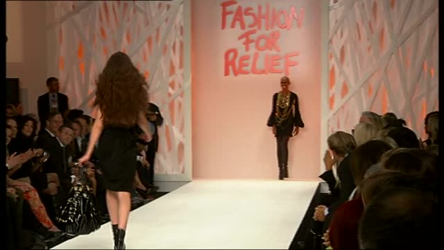 celebrity guests join models on catwalk at 'fashion for relief' fundraiser at london fashion week; skin along to end of catwalk then turning and... - black dress stock videos & royalty-free footage