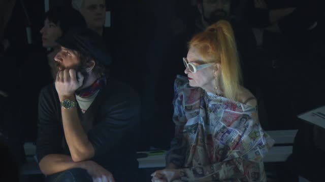 Fashion clothes designer Vivienne Westwood and her husband Andreas Kronthaler watch models on the catwalk during a rehearsal of the Gold Label AW1213...
