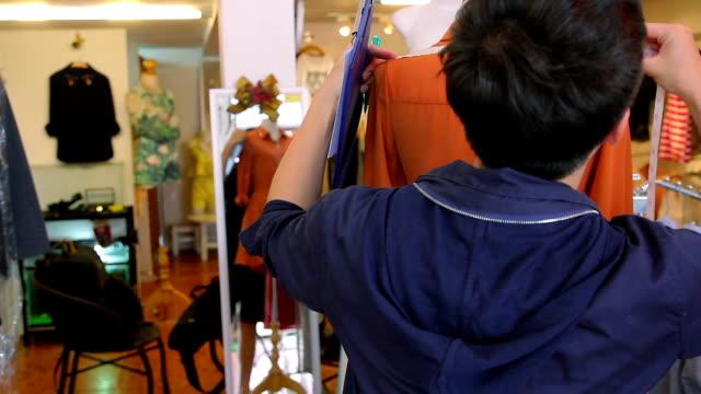 Fashion Designer adjusting clothes on a mannequin