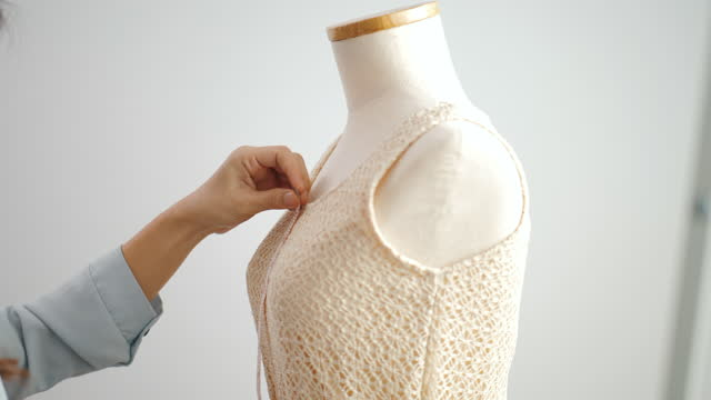 fashion designer designs and assists with the production of clothing - designer clothing stock videos & royalty-free footage