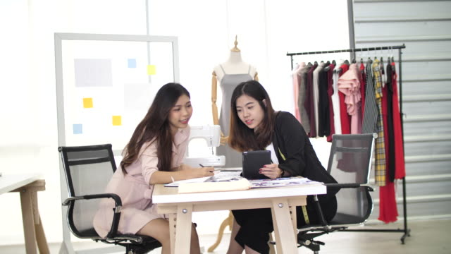 fashion designer drawing and working together - fashion designer stock videos & royalty-free footage