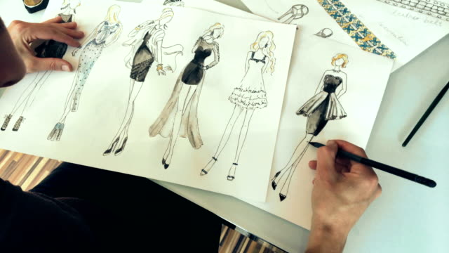 fashion designer drawing ideas and sketches indoors - fashion designer stock videos and b-roll footage