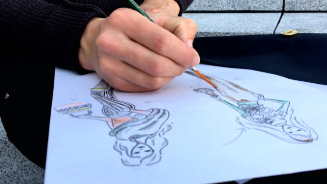 fashion designer drawing sketches outdoors in a city - fashion designer stock videos and b-roll footage
