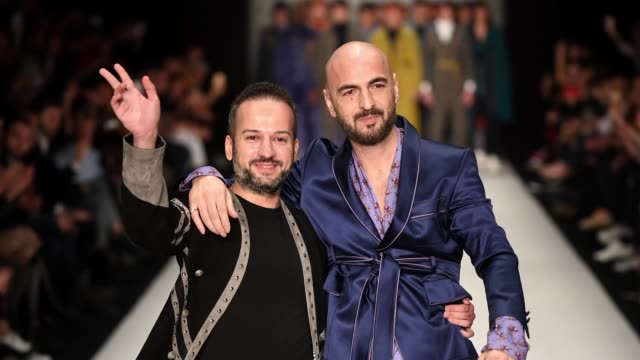 Fashion designer Emre Erdemoglu and singer Soner Sarikabadayi walk the runway at the Emre Erdemoglu show during Mercedes Benz Fashion Week Istanbul...