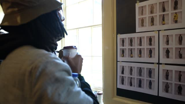 fashion designer foday dumbuya looking at look boards backstage during the labrum london show during london fashion week february 2021 at st giles in... - design professional stock videos & royalty-free footage