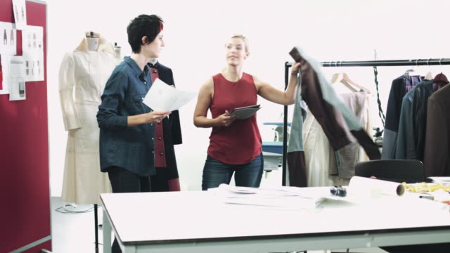 fashion designer looking at designs in studio - vanguardians stock videos & royalty-free footage