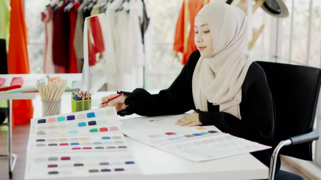 a fashion designer makes outlines on paper - fashion designer stock videos & royalty-free footage