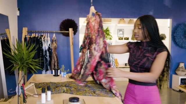 a fashion designer shows her clothing samples to a boutique owner. - owner stock videos and b-roll footage
