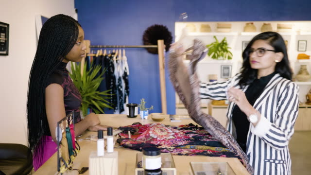 a fashion designer shows her clothing samples to a boutique owner. - salesman stock videos & royalty-free footage