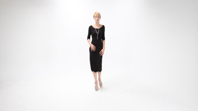 a fashion designer silver necklace - black dress stock videos & royalty-free footage