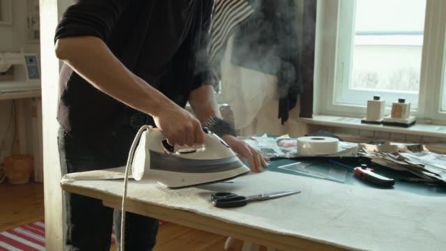 Fashion Designer steaming Sewing Pattern