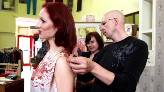 HD: Fashion Designer Taking Measurements