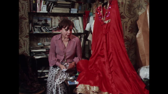 Fashion designer Thea Porter talks about the cost of making one of her elaborate evening gowns