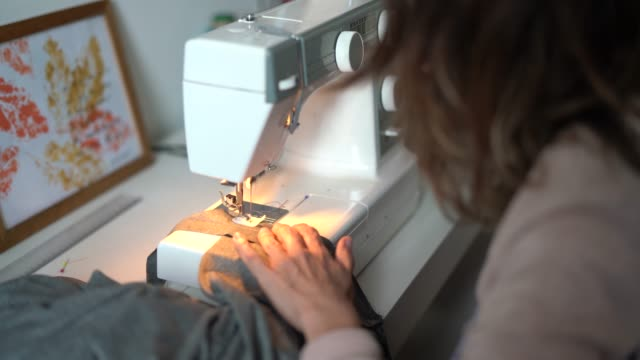fashion designer woman working at home - small business - sewing stock videos & royalty-free footage
