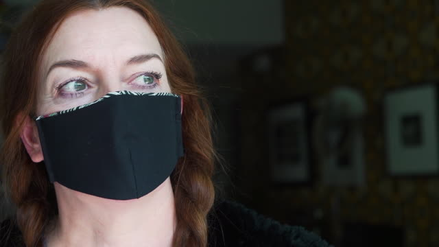 fashion designer working at home creates face masks from recycled fabric as protection against  viruses, disease and germs - home made stock videos & royalty-free footage