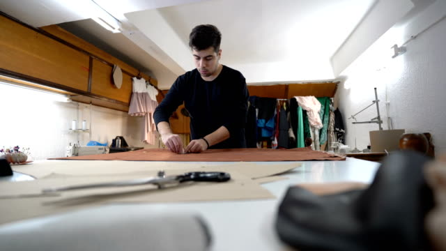 fashion designer working in atelier - atelier fashion stock videos & royalty-free footage