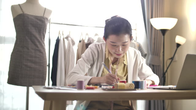 fashion designer working in her studio - designer clothing stock videos & royalty-free footage