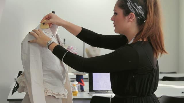 fashion designer working in studio - work tool stock videos & royalty-free footage