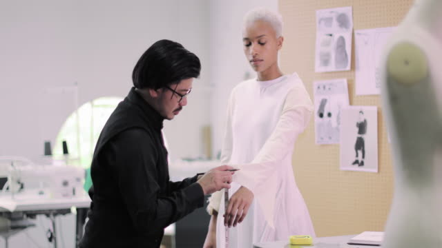 fashion designer working on design with a model - measuring stock videos & royalty-free footage