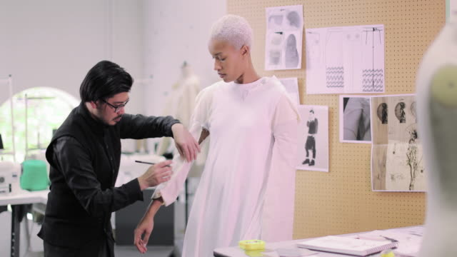 fashion designer working on design with a model - tailored clothing stock videos & royalty-free footage