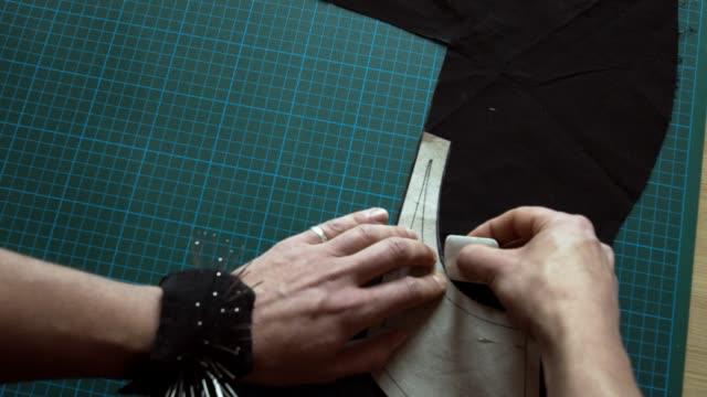 fashion designer working on dress pattern - designberuf stock-videos und b-roll-filmmaterial